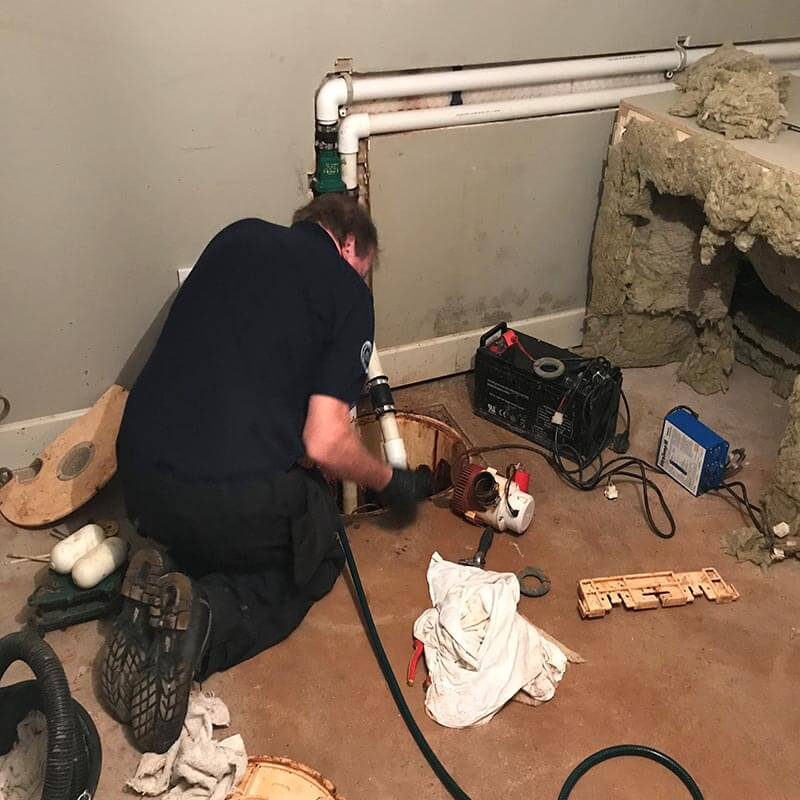 Sump Pump engineer installing basement sump pump